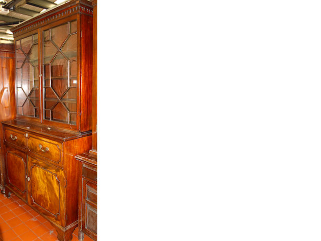 A George III mahogany secretaire bookcase,with astragal glazing above a fitted drawer and cupboard base on brackeet feet, 125cm