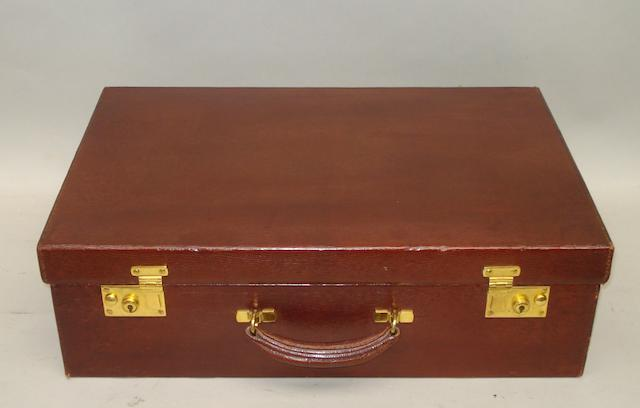 A brown leather suitcase,