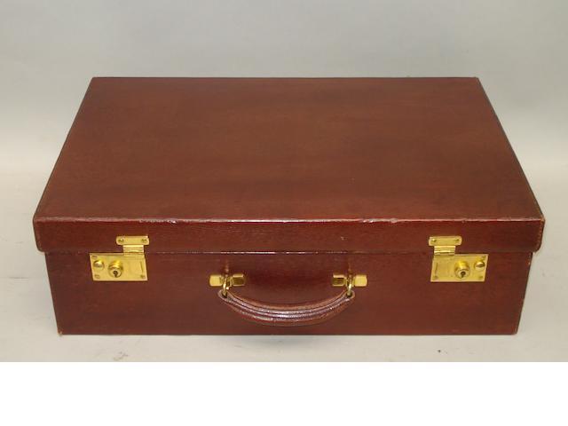 A brown suitcase, no maker,