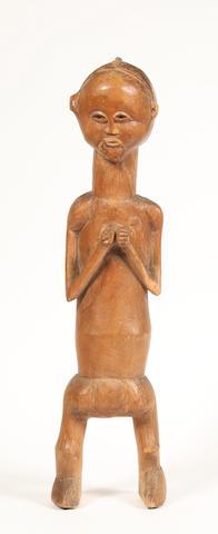 A Suku figure D.R. Congo 46cm high