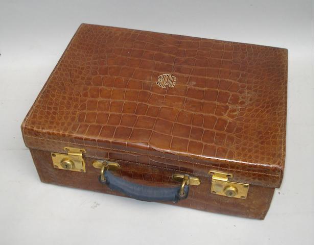 A crocodile skin dressing case, by Asprey & Co. Ltd,