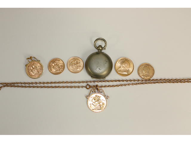 A collection of gold coins and coin pendants,