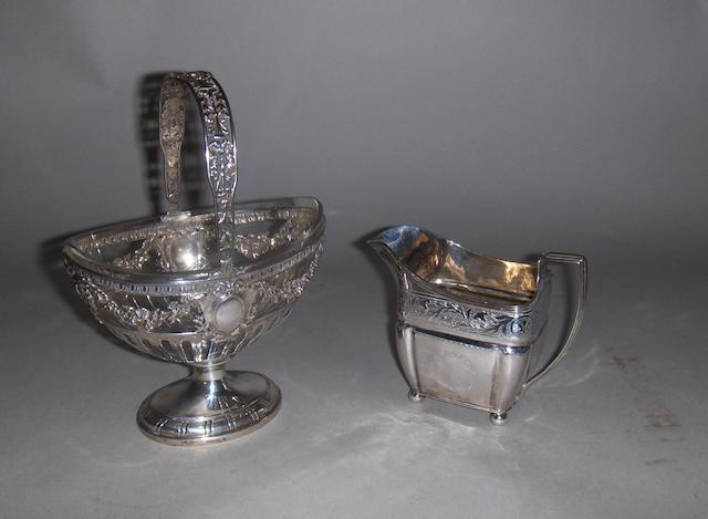 A 19th century continental white metal sugar basket and a Georgian cream jug