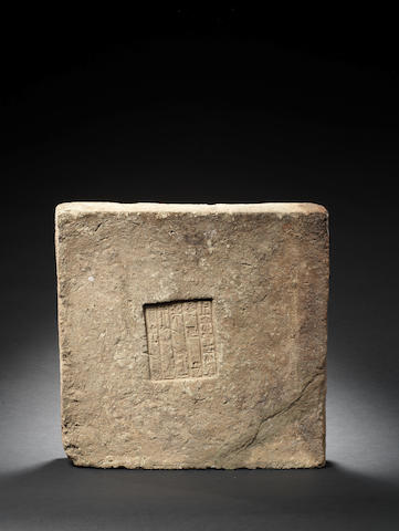 A Babylonian inscribed limestone block