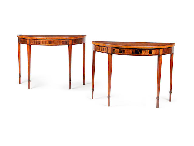 A pair of George III mahogany, rosewood banded and fruitwood marquetry demi lune tables
