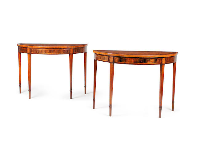 A pair of George III style mahogany, rosewood banded and fruitwood marquetry demi lune tables