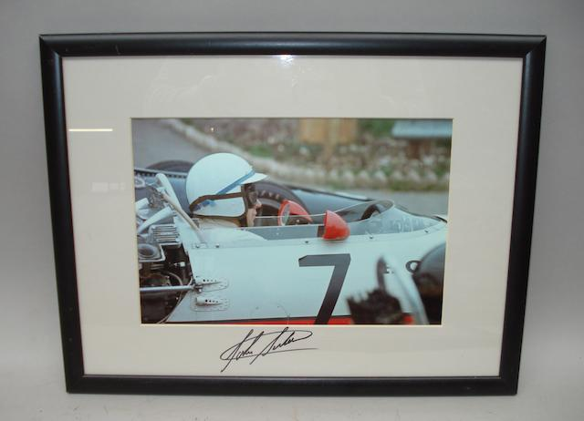 A signed photograph of John Surtees,