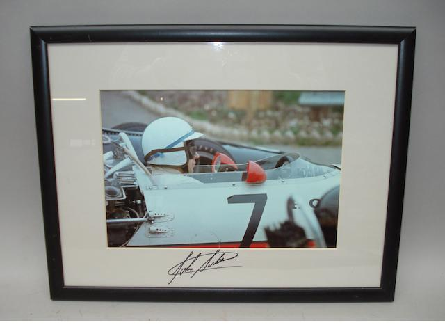 A signed photograph of John Surtees