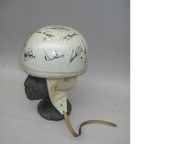 A signed 1950s/1960s white race helmet
