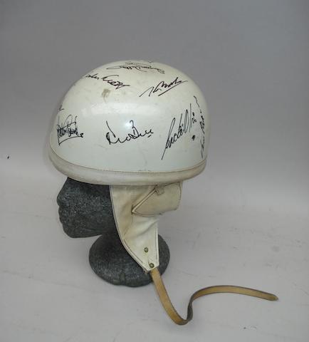 A signed 1950s/1960s white race helmet
