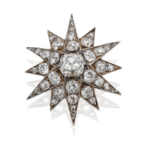 A late 19th century diamond star brooch/pendant,