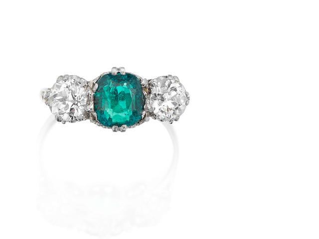 An early 20th century emerald and diamond three-stone ring