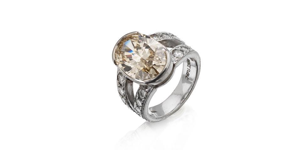A coloured diamond single-stone ring