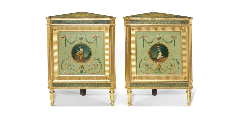 A pair of George III painted and parcel-gilt corner cabinets on stands attributed to Henry Clay
