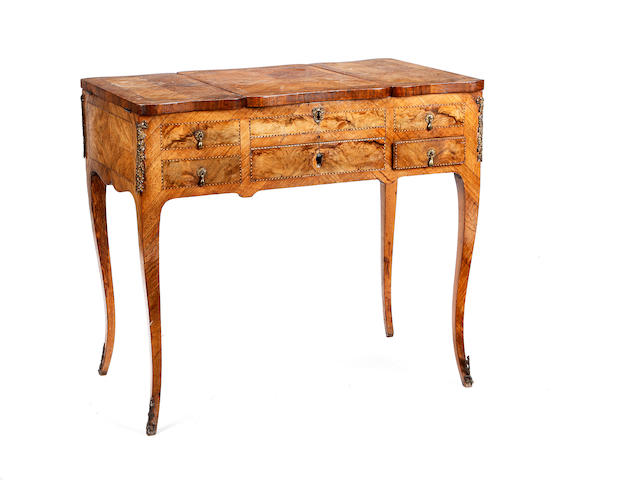 A Louis XV/XVI transitional figured walnut and chequerbanded poudreuse