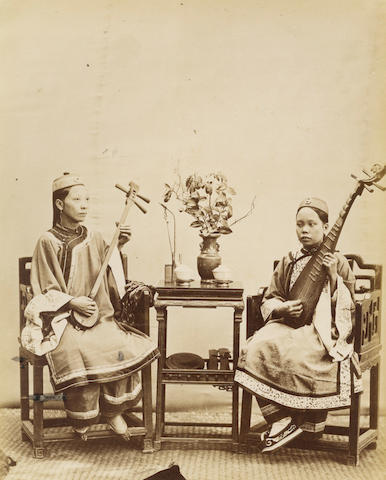 CHINA - CANTON TYPHOON An album of 40 views of the typhoon and numerous portraits of women, [c.1878]