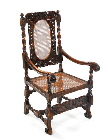 A Charles II style walnut and cane open armchair