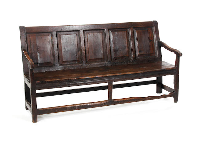 An early 18th Century oak settle
