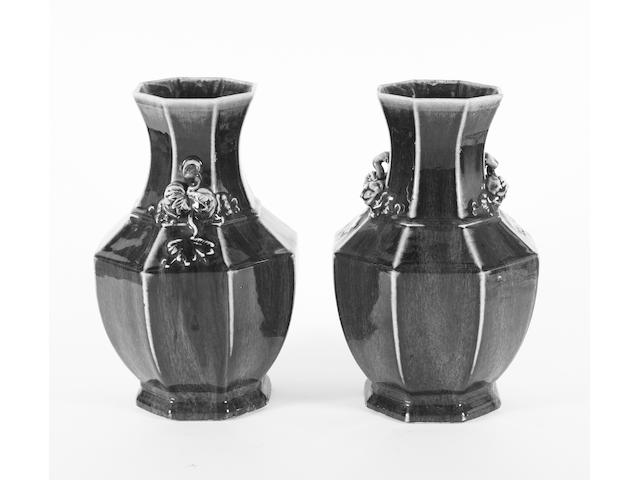 A pair of Chinese octagonal sang de boeuf vases