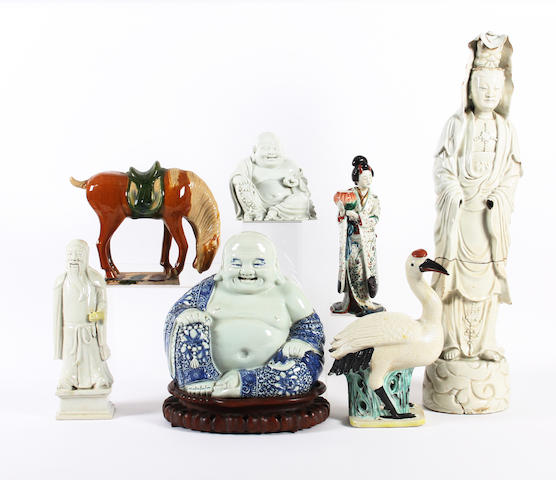 A large Chinese blue and white figure of a seated buddah, four other figures, a Tang style model of a horse and a model of a bird