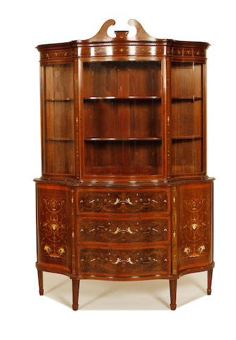 An Edwardian mahogany, satinwood, fruitwood and ivory marquetry serpentine display cabinet by Edwards and Roberts