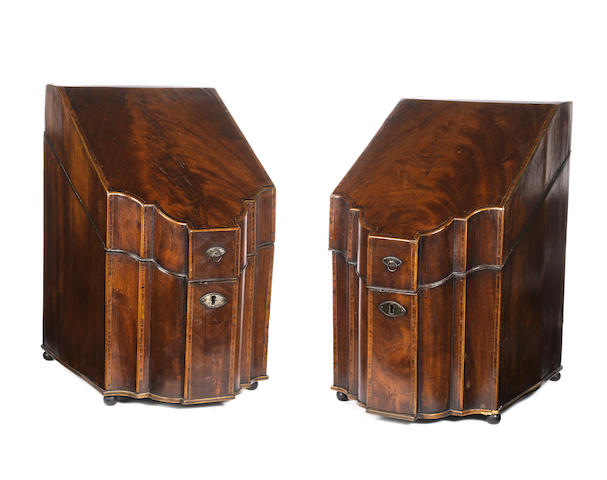A pair of George III mahogany and tulipwood banded serpentine knife boxes