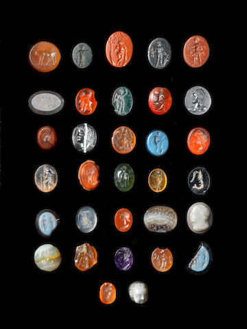 A group of 32 ancient hardstone gems; 1 lapis lazuli baroque magic style gem; 18 after the antique gems; and a quantity of glass impressions