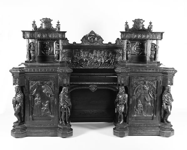 A late 19th century carved oak twin pedestal sideboard based on the 'Kenilworth Buffet' of 1851 by Cookes and Son of Warwick
