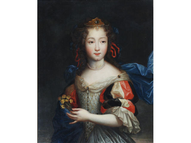 Circle of Pierre Mignard I (French, 1612-1695) Portrait of a young woman, half length, holding a posy 42 x 33cm.