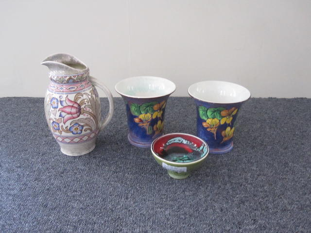 A Charlotte Rhead Art Deco jug together with a pair of Royal Doulton flared vases and a Poole pottery bowl,(4).