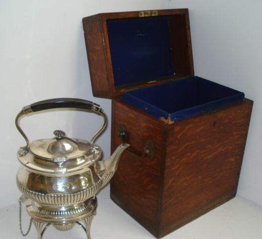 A late Victorian silver tea kettle on spirit heater stand,William Hutton & Sons, Sheffield 1900, in Regency style, oval part lobed and fluted, 34cm, 50ozs, in fitted oak baize lined case retailed by Army & Navy C.S.L.