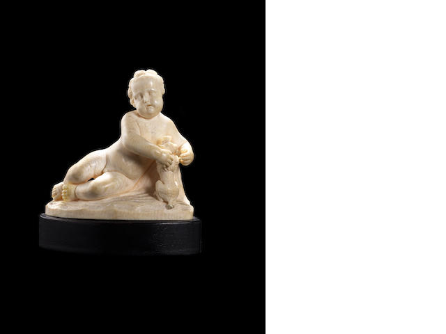 After Francois Duquesnoy, Flemish (1597-1643) An 18th century ivory figure of a boy with a dog