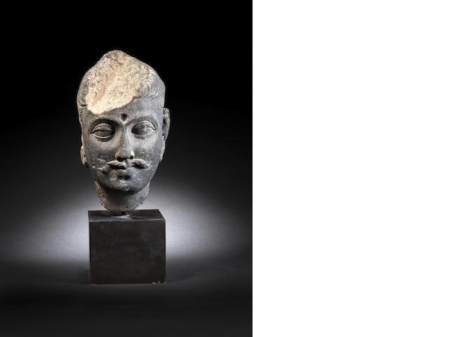 A Gandharan schist Head, 2nd/ 3rd Century