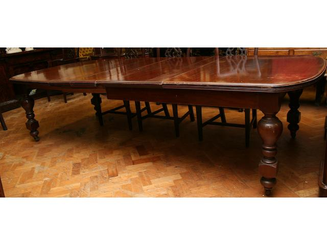 A Victorian mahogany wind-out dining table