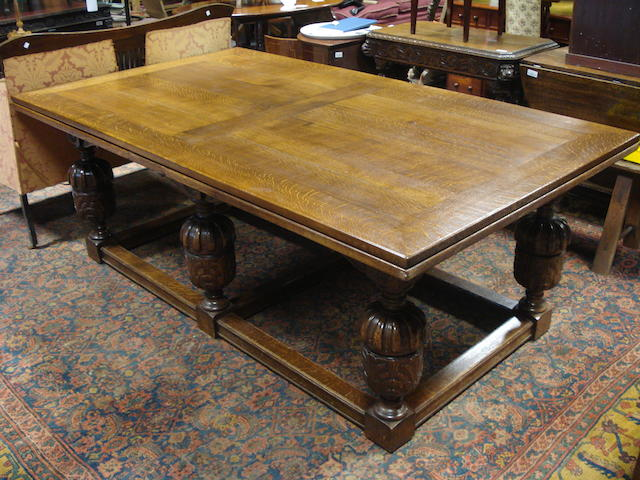 A 17th century-style draw-leaf dining table