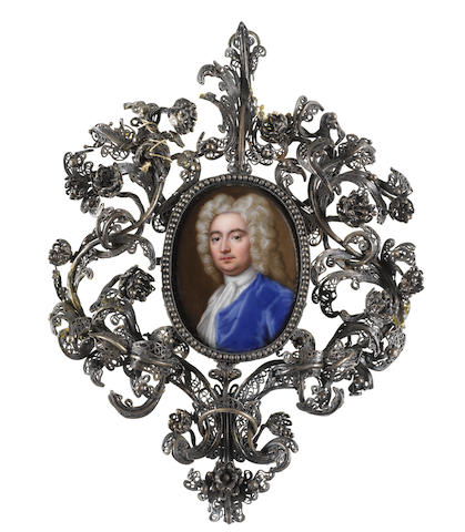 Christian Friedrich Zincke (German, 1683/4-1767) A Gentleman, wearing blue coat, white chemise, lace cravat and stock, long curled powdered wig