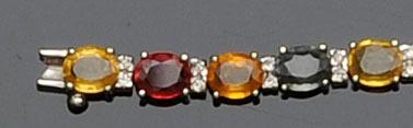 A multi-coloured sapphire and diamond bracelet