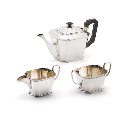 An Art Deco style metalware  three-piece tea service, incuse mark only STERLING SILVER,  (Qty)