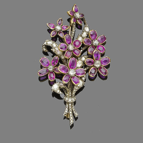 A mid 19th century ruby and diamond flower brooch