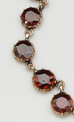 An early 19th century garnet rivière necklace