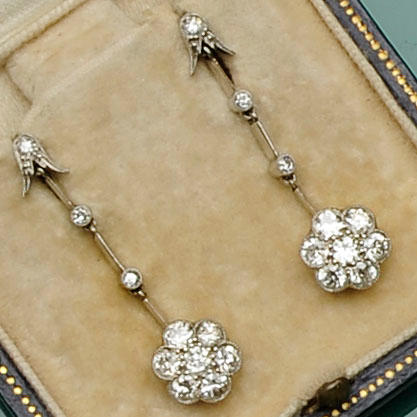 A pair of diamond flowerhead cluster drop earrings