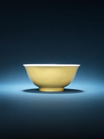 An incised yellow-glazed 'dragon' bowl. Previously listed as 'Item not consigned' but received at NBS.  Kangxi six-character mark and of the period