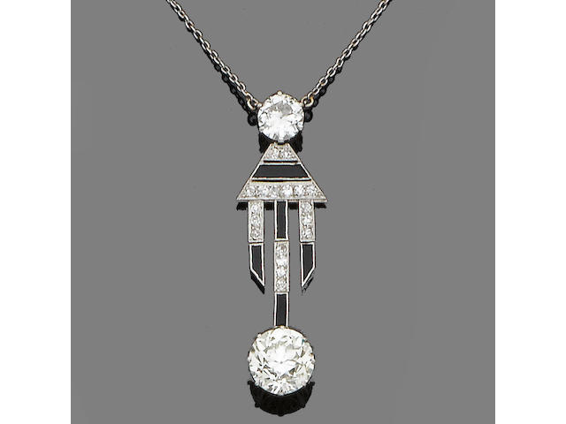 An art deco diamond and onyx pendant necklace,
