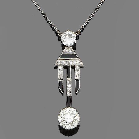 An art deco diamond and onyx pendant necklace,