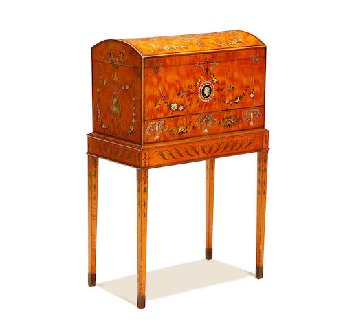 An Edwardian satinwood, rosewood crossbanded and polychrome decorated coffer-on-stand in the Sheraton style