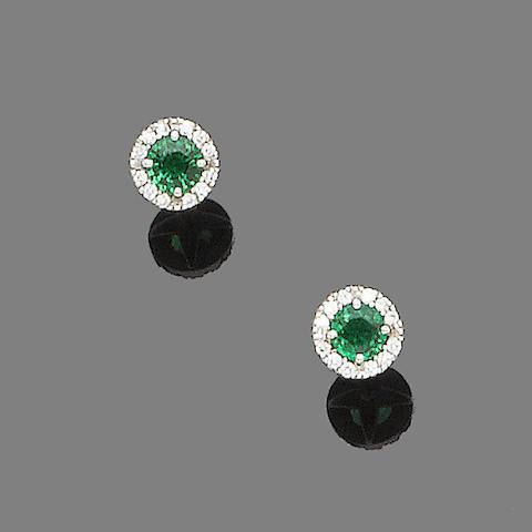 A pair of tsavorite garnet and diamond cluster earstuds
