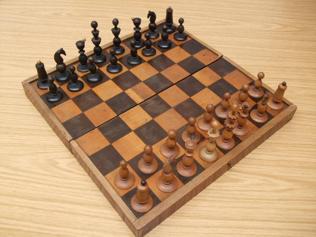 "A ""Coffee House"" boxwood chess set, Austrian, mid 19th century,"