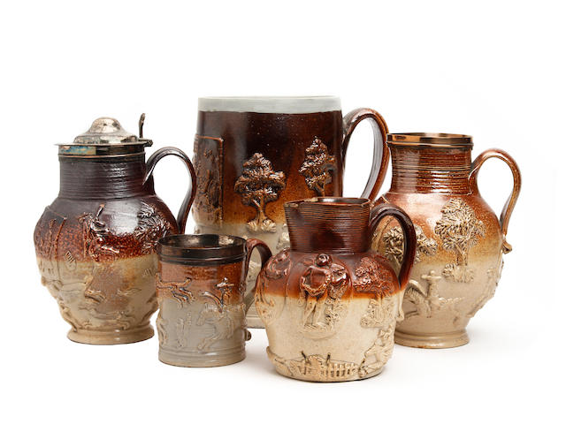 A small collection of relief-moulded hunting jugs, early 19th century