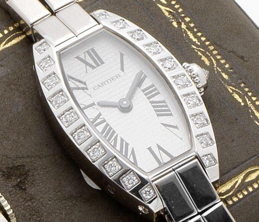 Cartier. An 18ct white gold and diamond set quartz bracelet watchCase No.47439CE, Sold 26th January 2004
