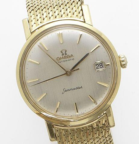 Omega. An 18ct gold automatic calendar bracelet watchSeamaster, 1960's